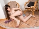 Adriana Vittoria has naked fun in her armchair