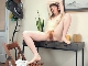 Roxanne strips naked at her grey desk
