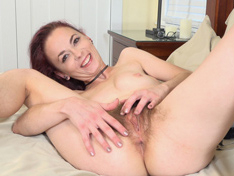 Ivy Addams relaxes in bed as she masturbates