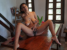 Sofia Cuty strips naked on her table