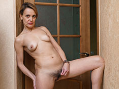 Ivanna strips naked to masturbate in her hallway