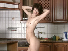 Slender Milf Milady in the kitchen.