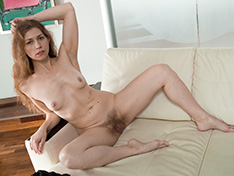 Elza enjoys a new white sofa by stripping naked