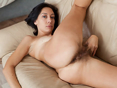 Hairy girl Eva spreads her all natural muff
