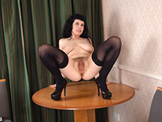 Suzie strips naked on her dining table