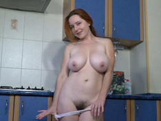 Elouisa strips naked in her blue kitchen