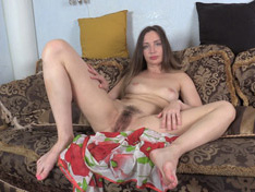 Alexa enjoys masturbating on her brown couch